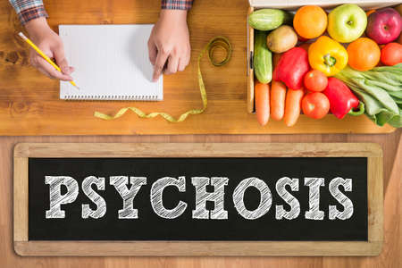 psychosis: PSYCHOSIS fresh vegetables and  on a wooden table