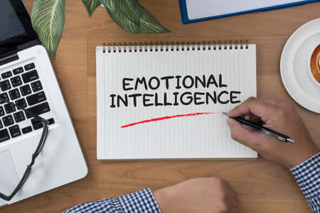 decreased: EMOTIONAL INTELLIGENCE man hand notebook and other office equipment such as computer keyboard Stock Photo
