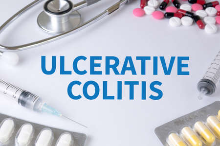 ULCERATIVE COLITIS Text, On Background of Medicaments Composition, Stethoscope, mix therapy drugs doctor flu antibiotic pharmacy medicine medical Stock Photo