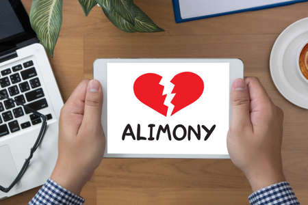 alimony: Alimony man hand Tablet and coffee cup