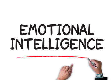 emotional intelligence: EMOTIONAL INTELLIGENCE businessman work on white broad, top view