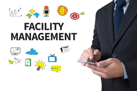 customer records: FACILITY MANAGEMENT businessman working use smartphone