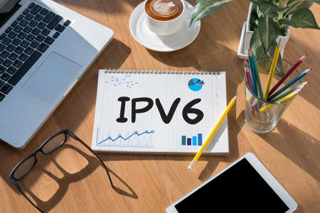 ip address: IPV6      Internet Protocol larger address space  open book on table and coffee Business