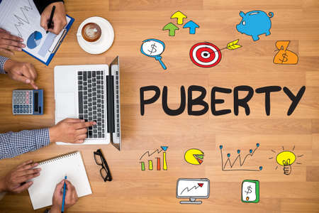 puberty: PUBERTY Business team hands at work with financial reports and a laptop Stock Photo