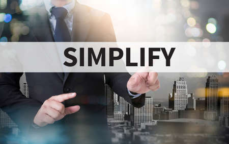 straightforward: SIMPLIFY and businessman working with modern technology Stock Photo