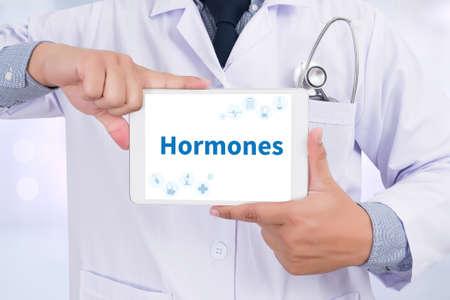 Hormones Business development Doctor holding  digital tablet Stock Photo