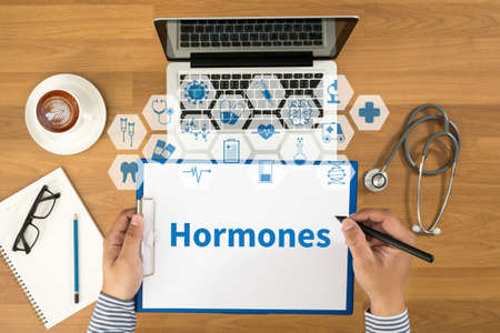 Hormones Business development Top view, Doctor writing medical records on a clipboard, medical equipment Stock Photo