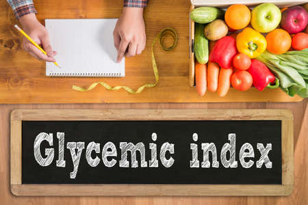 glycemic: Glycemic index fresh vegetables and  on a wooden table