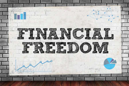 freedom concept: FINANCIAL FREEDOM on brick wall and poster concept
