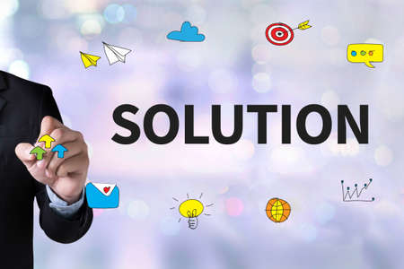 asian business team: SOLUTION ( Solution Innovation Progress Strategy Decision ) and Businessman drawing Landing Page on white background