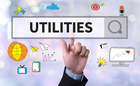 utilities: UTILITIES man pushing (touching) virtual web browser address bar or search bar on blurred abstract background