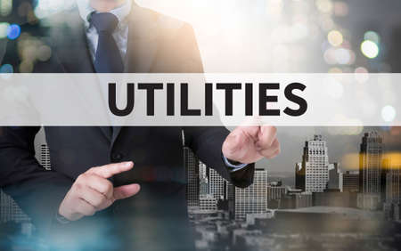 budgets: UTILITIES and businessman working with modern technology