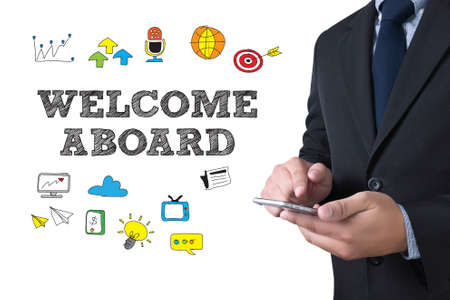aboard: WELCOME ABOARD businessman working use smartphone Stock Photo
