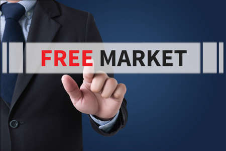 oversight: FREE MARKET Businessman hands touching on virtual screen and blurred city background