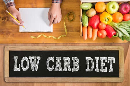 LOW CARB DIET fresh vegetables and  on a wooden table