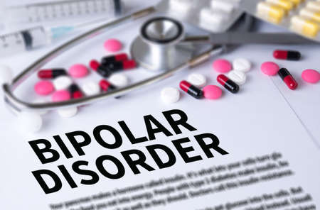 psychosocial: BIPOLAR DISORDER and Background of Medicaments Composition, Stethoscope, mix therapy drugs doctor and selectfocus Stock Photo