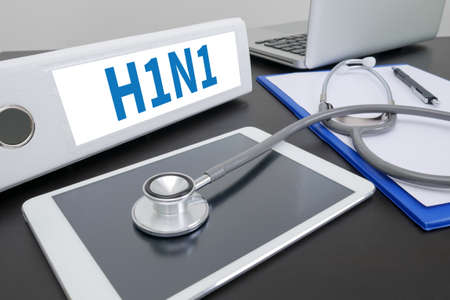 h1n1: H1N1 folder on Desktop on table.