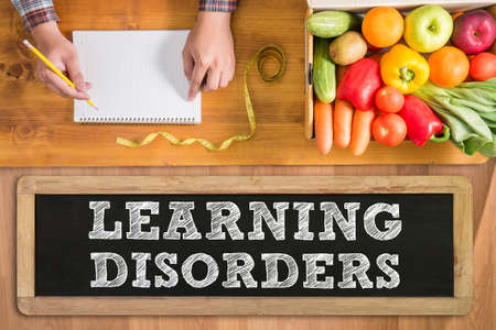 hyperactivity: LEARNING DISORDERS fresh vegetables and  on a wooden table