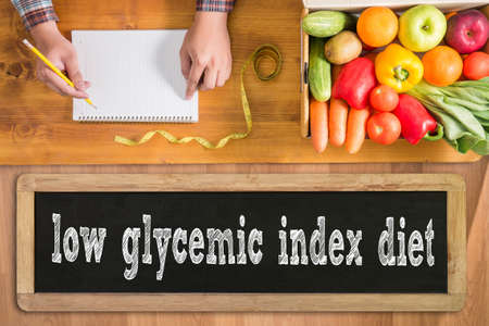 glycemic: low glycemic index diet fresh vegetables and  on a wooden table