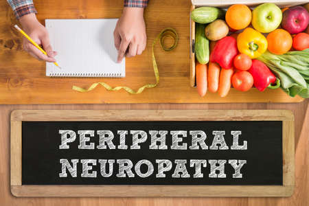 PERIPHERAL NEUROPATHY fresh vegetables and  on a wooden table Stock Photo - 59957736