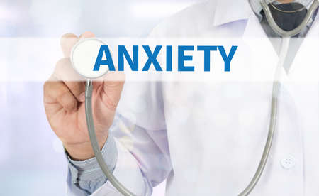 generalized: ANXIETY Medicine doctor hand working on virtual screen Stock Photo