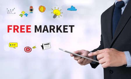 unfair rules: FREE MARKET Businessman use a tablet computer