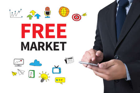 unfair rules: FREE MARKET businessman working use smartphone Stock Photo