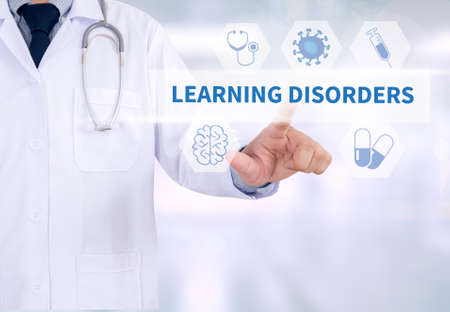 behavioral: LEARNING DISORDERS Medicine doctor working with computer interface as medical Stock Photo