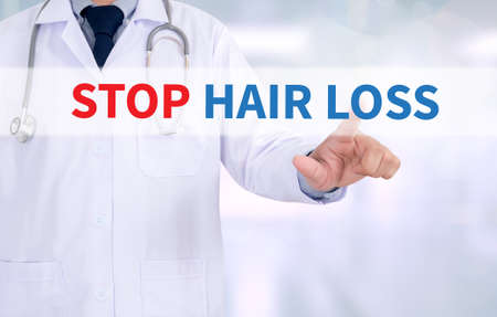 STOP HAIR LOSS Medicine doctor working with computer interface as medical Standard-Bild