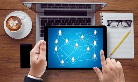 diversity domain: NETWORK (Network System Online Internet Web), on the tablet pc screen held by businessman hands - online, top view Stock Photo