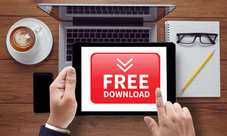 downloadable: Free Download, on the tablet pc screen held by businessman hands - online, top view