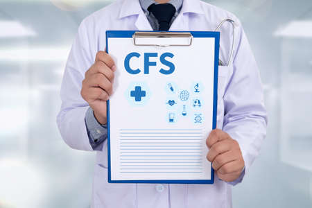 financial statement: CFS  (Consolidated Financial Statement) Portrait of a doctor writing a prescription Stock Photo