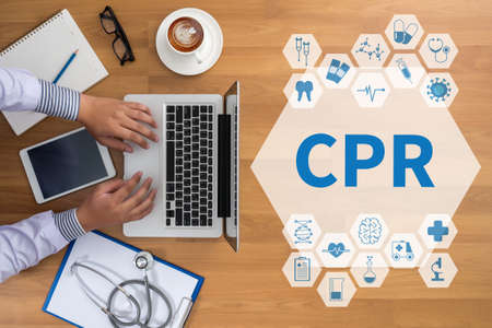 resuscitate: CPR      Cardiopulmonary resuscitation Basic life support ( BLS )and Advanced cardiac life support ( ACLS )( mouth to mouth Professional doctor use computer and medical equipment all around, desktop top view, coffee