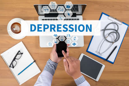 major depression: DEPRESSION Doctor working at office desk and using a mobile touch screen phone, computer and medical equipment all around, top view, coffee