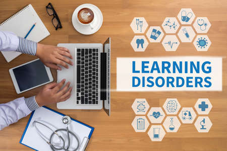 use computer: LEARNING DISORDERS Professional doctor use computer and medical equipment all around, desktop top view, coffee