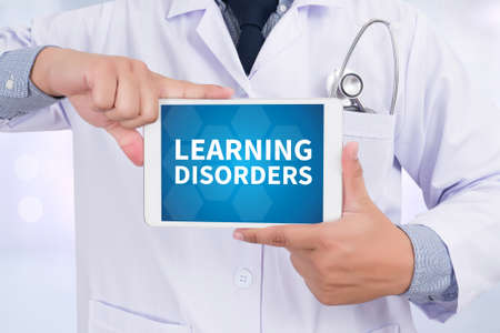 hyperactivity: LEARNING DISORDERS Doctor holding  digital tablet