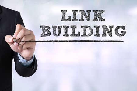 link building: LINK BUILDING Businessman drawing Landing Page on blurred abstract background