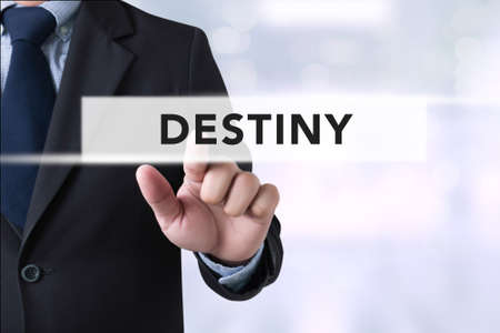 destiny: DESTINY CONCEPT Businessman hands touching on virtual screen and blurred city background Stock Photo