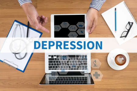 major depression: DEPRESSION Doctor touch digital tablet, desktop with medical equipment on background, top view, coffee
