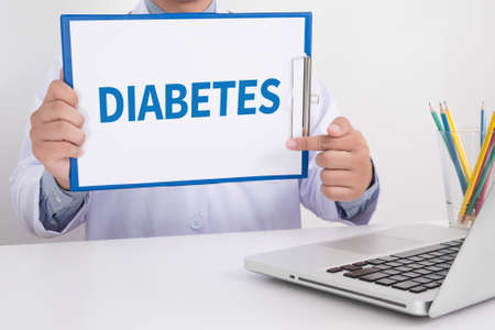 hyperglycemia: DIABETES  Doctor showing clipboard on your personal message or advice, doctor hand working Stock Photo