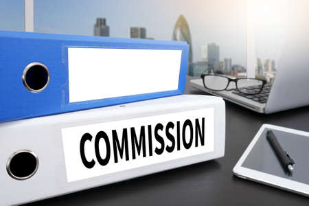 commission: COMMISSION Office folder on Desktop on table with Office Supplies. Stock Photo