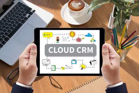 interactions: CLOUD CRM Businessman work  on tablet on screen Stock Photo