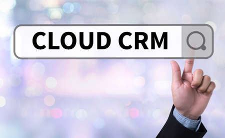 interactions: CLOUD CRM man pushing (touching) virtual web browser address bar or search bar on blurred abstract background Hand Touching Cloud CRM Stock Photo