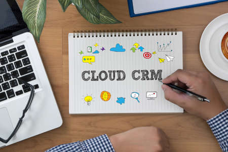 interactions: CLOUD CRM man hand notebook and other office equipment such as computer keyboard Hand Touching Cloud CRM