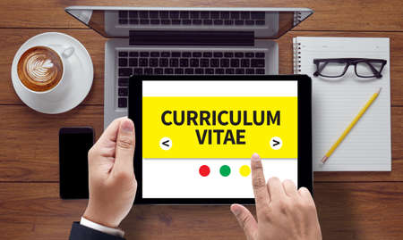 finding a job: CURRICULUM VITAE professional resume for finding a job, on the tablet pc screen held by businessman hands - online, top view Stock Photo