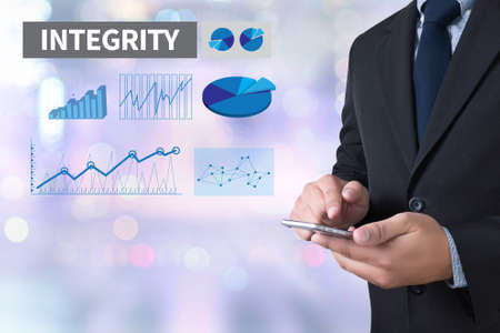 INTEGRITY   Ethics Loyalty Moral Motivation businessman working use smartphone on blurred abstract background
