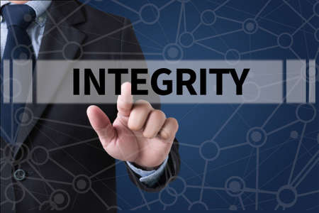 INTEGRITY   Ethics Loyalty Moral Motivation Businessman hands touching on virtual screen and blurred city background
