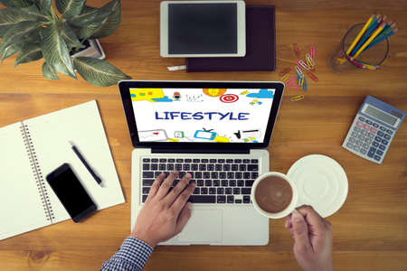 way up: Lifestyle your Way of Life Habits Situation Culture up to you Laptop and coffee cup in man work hands sitting on a wooden table
