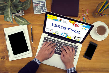 Lifestyle your Way of Life Habits Situation Culture up to you Close up of business man hand working  laptop computer on wooden desk