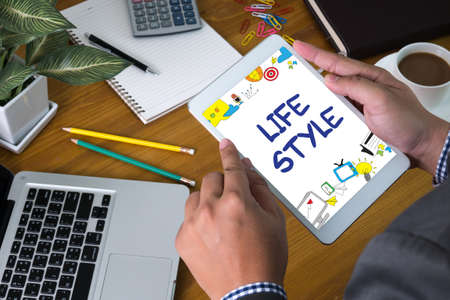 Lifestyle your Way of Life Habits Situation Culture up to you Businessman sitting at office desk  and holding  digital tablet,  coffee break,
